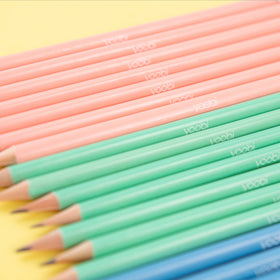close up of pre-sharpened pencils showing blush, mint and blue color and white yoobi logo on barrel of each pencil