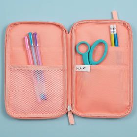inside of open blush pencil organizer showing mesh pocket on one side and 2 pockets on opposite side, showing pens, pencils and scissors inside pockets
