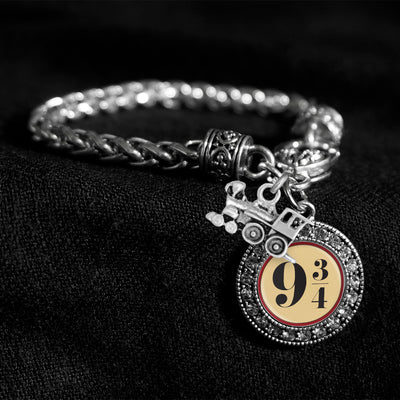 9 3/4 Train Silver Braided Clasp Charm Bracelet