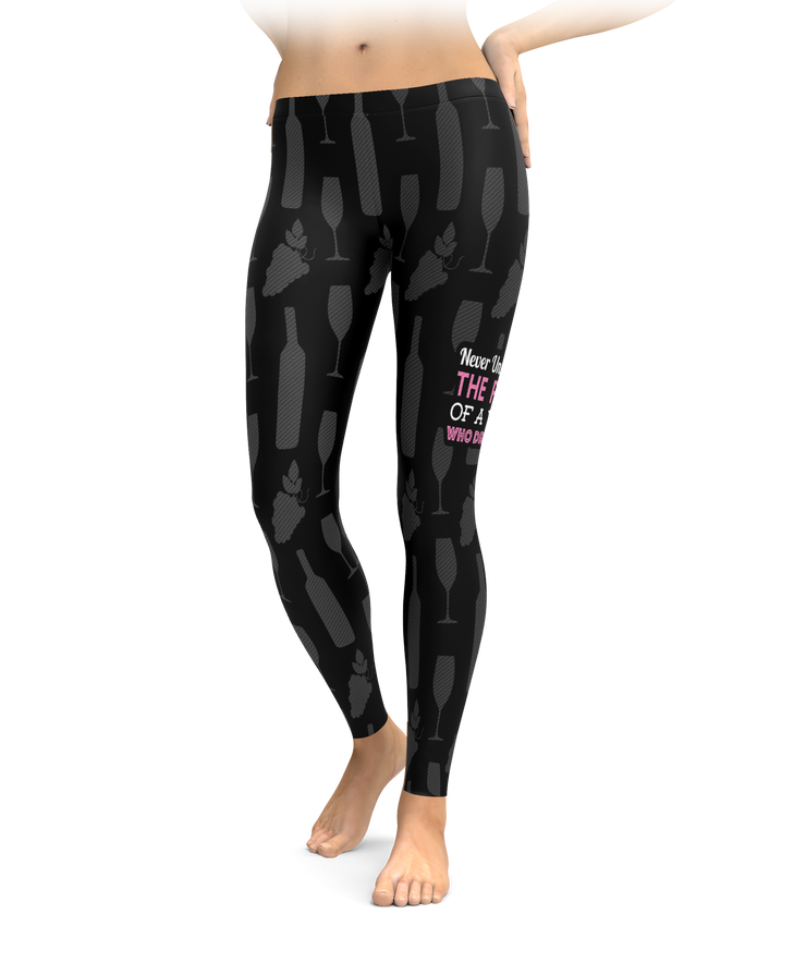Never Underestimate The Power Of A Woman Who Drinks Wine Leggings