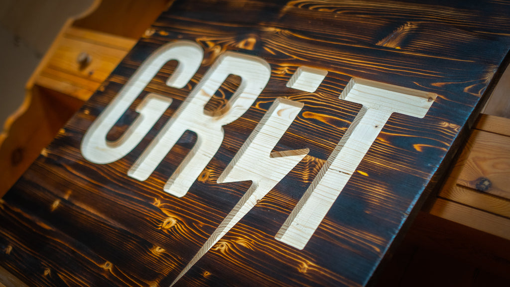 GRIT Pictures sign by dusty barn