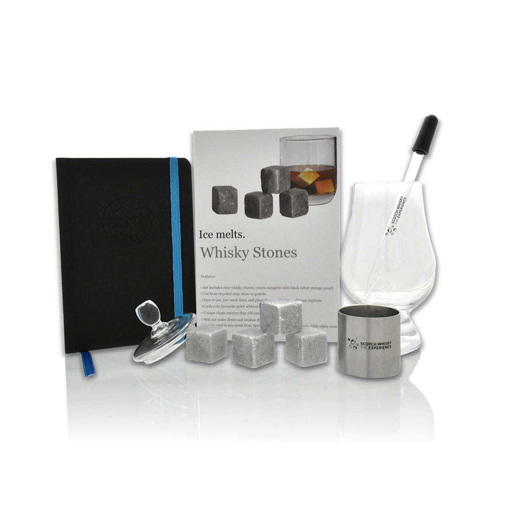 Box of whisky stones, tasting journal, Glencairn whisky glass, a tasting glass cap, a water dropper and a 25ml pewter measure