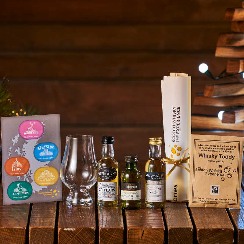 Gift pack showing virtual whisky tasting package which includes 3 miniature whiskies, hot toddy sachet, distillery map, glencairn whisky tasting glass