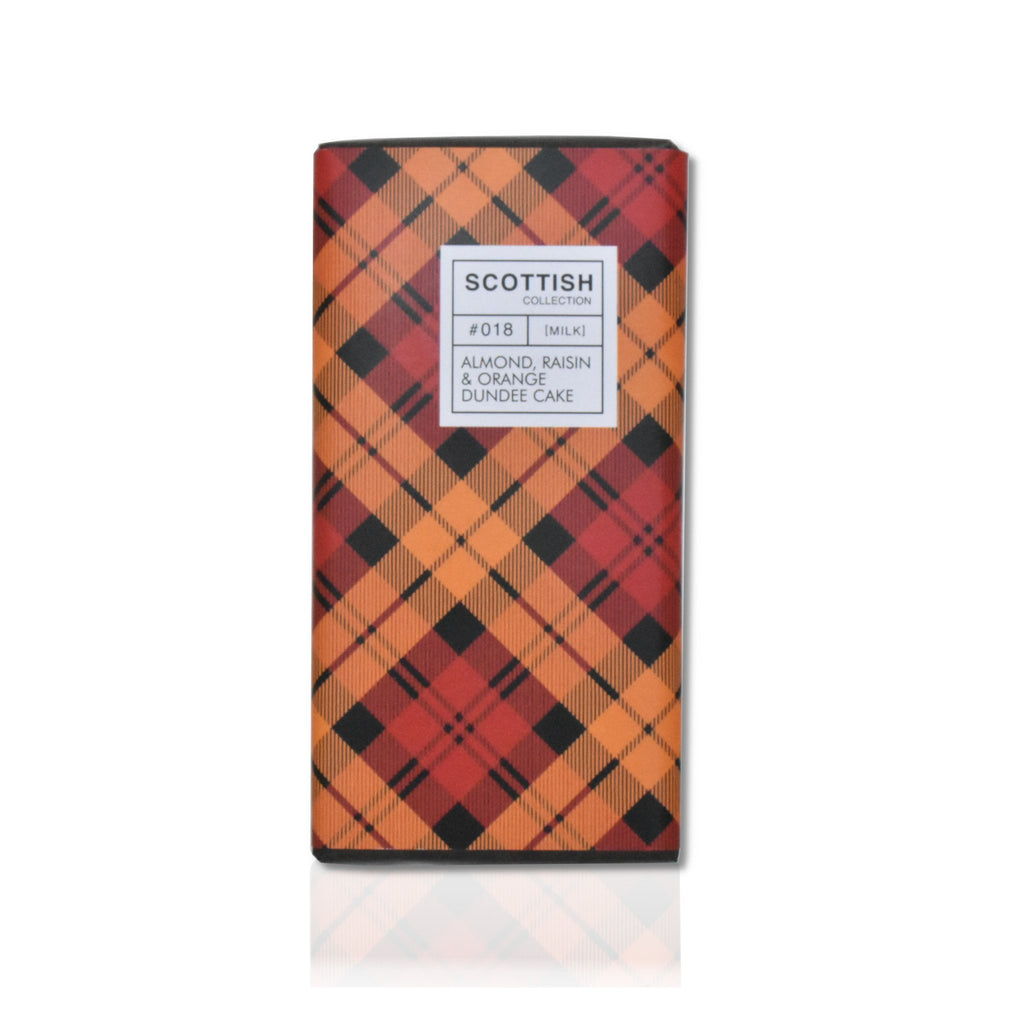 Bar of almond, raisin and orange milk chocolate in tartan wrapping