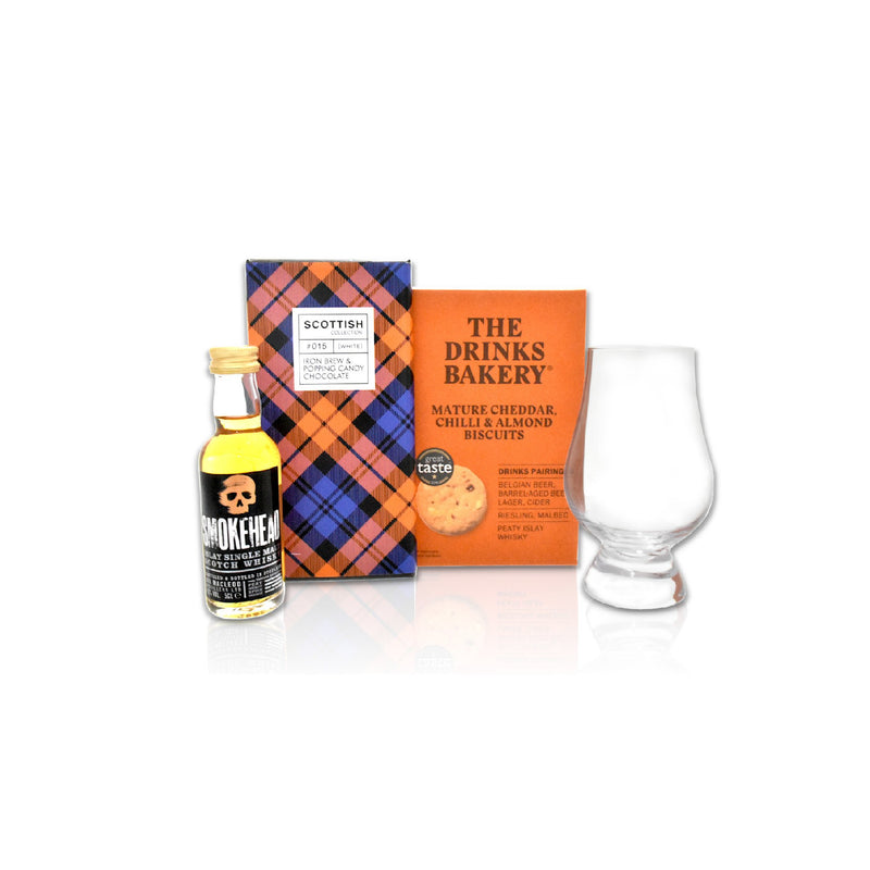 Mature cheddar and chilli biscuits, 5cl Smokehead whisky miniature, Iron Brew  Chocolate bar with popping candy, Glencairn glass
