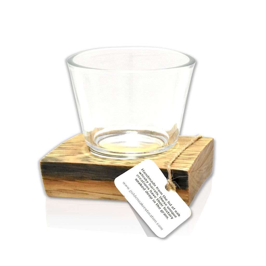 A wooden stave and glass single candle holder