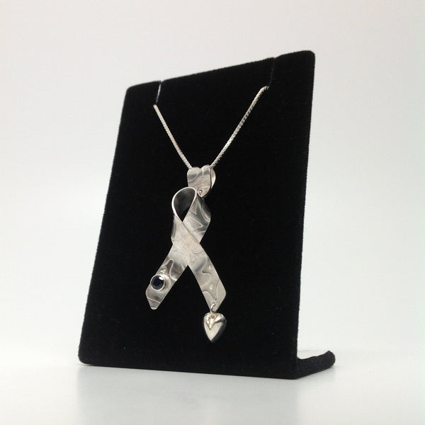 Cancer Ribbon with a Blue Saphire