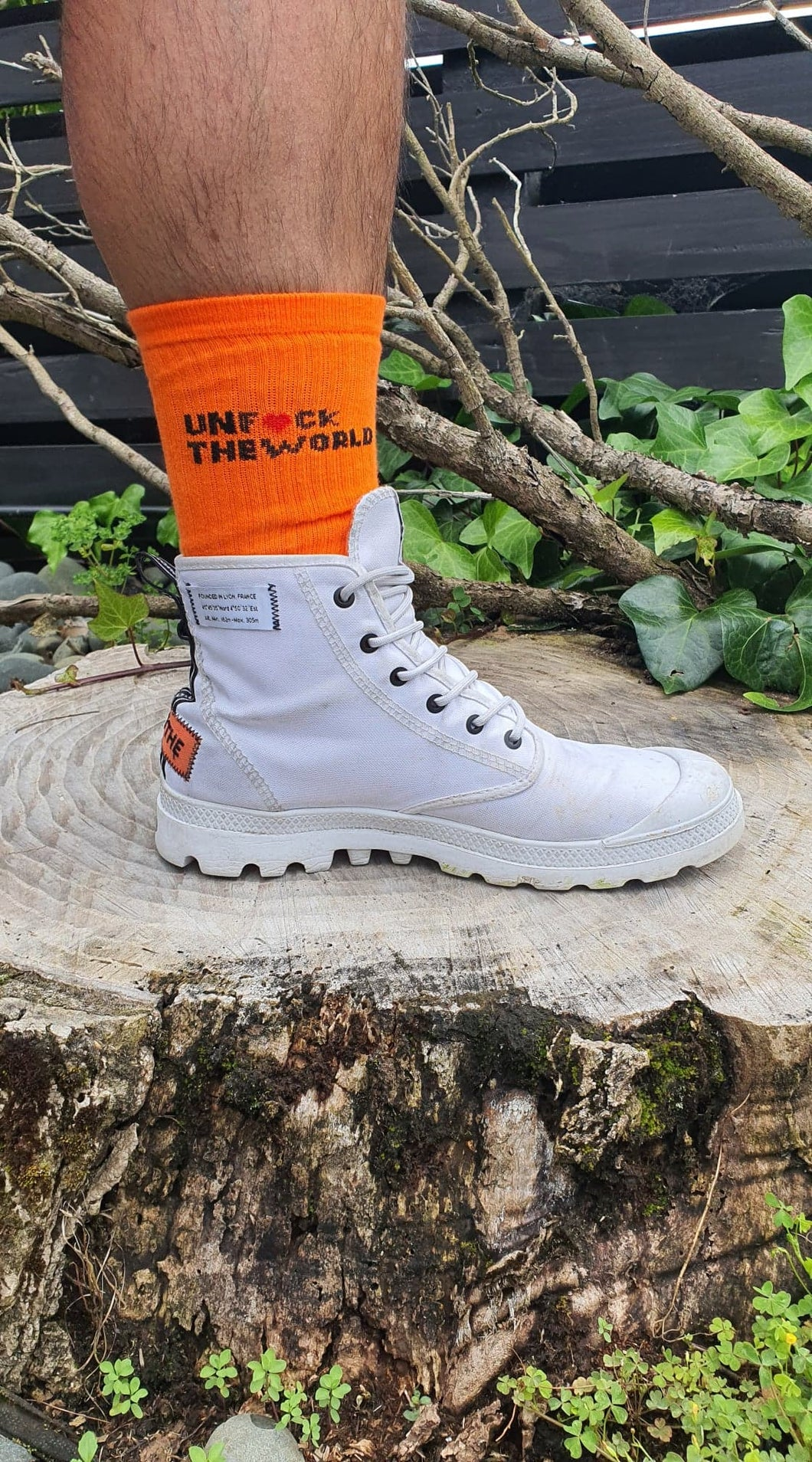Unisex: Unf*ck The World Socks in Hot Orange
