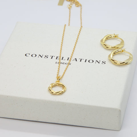 Constellations London jewellery laid out on Constellations London branded conscious jewellery gift boxes