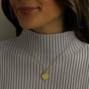 How to style gold medallion coin necklace with your winter cosy jumpers
