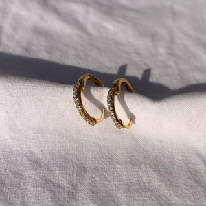 Sparkling diamond cubic zirconia stones on plain gold huggie hoop earrings