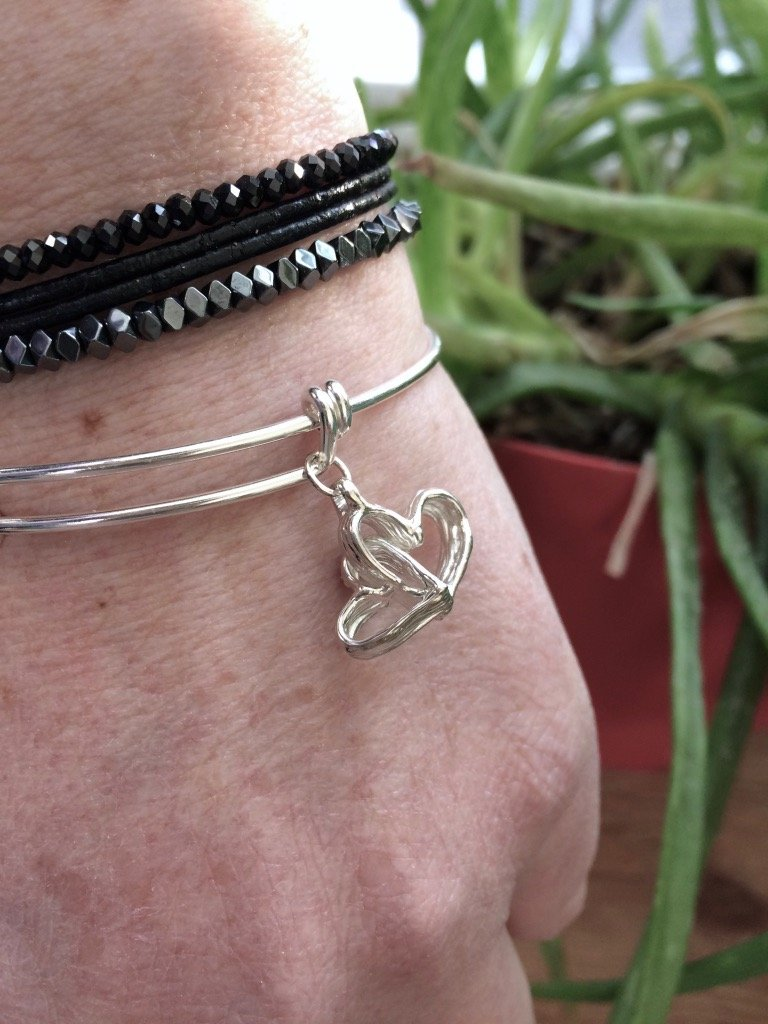 Intertwined Hearts - adjustable bracelet - Amanda Schoppel Art & Wax Carving