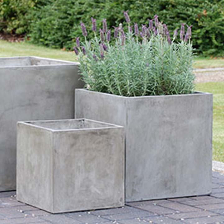 image of three different sized square pots one with lavender on a stoned ground