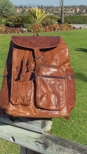 Load and play video in Gallery viewer, Hand tooled unisex backpack
