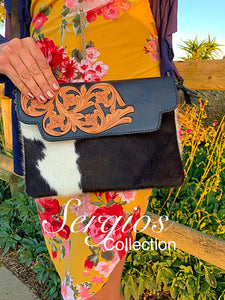 Tooled cowhide enveloped crossbody bag