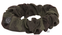 Load image into Gallery viewer, https://shop.lululemon.com/p/women/Uplifting-Scrunchie/_/prod8640243?color=35551&sz=ONESIZE