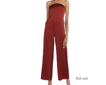 Load image into Gallery viewer, https://www.express.com/clothing/women/satin-strapless-wide-leg-jumpsuit/pro/07925240/color/DEEP%20HENNA/