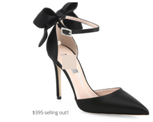 Load image into Gallery viewer, https://www.saksfifthavenue.com/product/sjp-by-sarah-jessica-parker-trance-bow-satin-ankle-strap-pumps-0400090383314.html?dwvar_0400090383314_color=BLACK