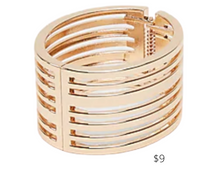 Load image into Gallery viewer, https://www.express.com/clothing/women/cut-out-hinge-bangle/pro/00507095C/color/Shiny%20Gold/