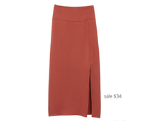 Load image into Gallery viewer, https://www.express.com/clothing/women/high-waisted-satin-front-slit-midi-skirt/pro/07739519/color/Henna/#reviews