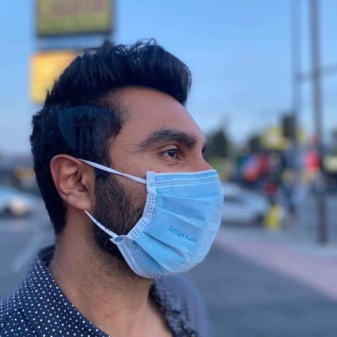 respokare mask antiviral worn by an adult male outside