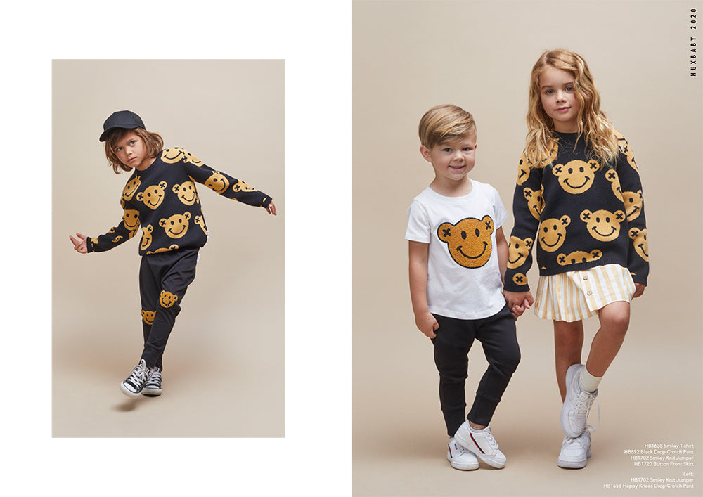 Children wearing organic cotton styles from the new season Huxbaby Be Happy Collection.