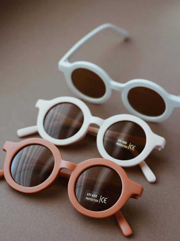 Grech & Co sunglasses in buff colourway, beautiful sustainably made sunglasses for children.