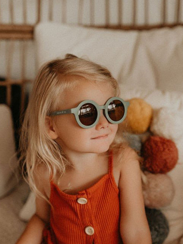 Grech & Co sunglasses in fern colourway, beautiful sustainably made sunglasses for children.