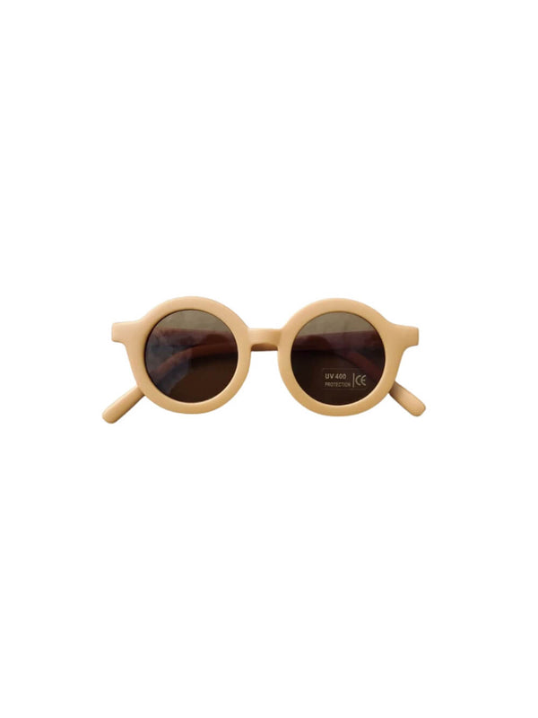 Grech & Co sunglasses in golden colourway, beautiful sustainably made sunglasses for children.