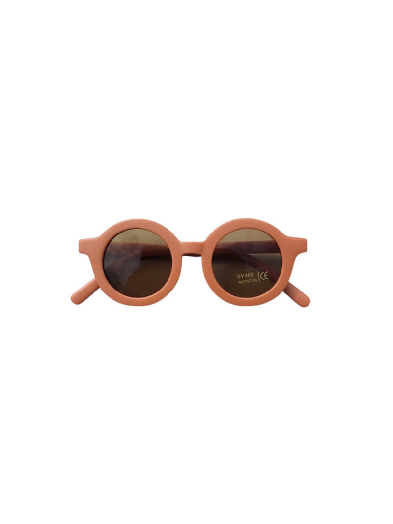 Grech & Co sunglasses in rust colourway, beautiful sustainably made sunglasses for children.