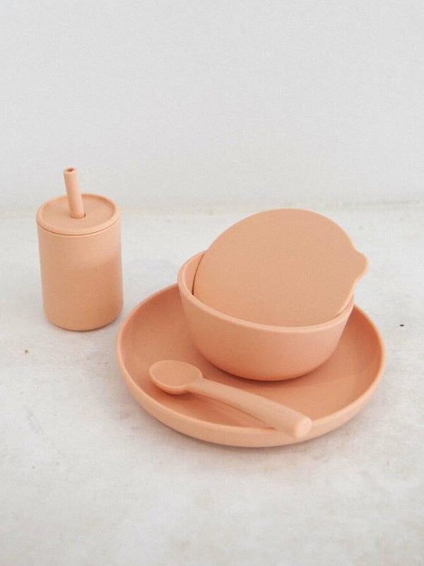 Rommer dinnerware set in melon features silicone bowl, plate, spoon and drink bottle. Perfect for meal times.