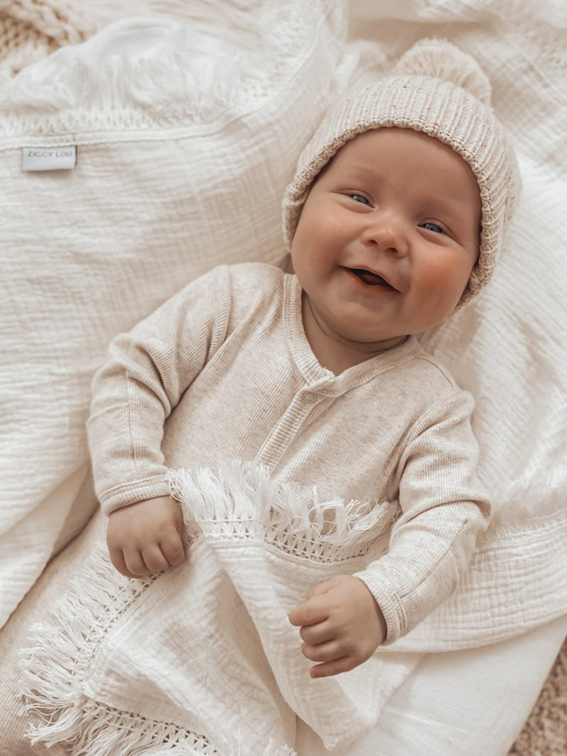 Wrap your little one in our gorgeous Ziggy Lou fringe swaddle. The perfect blanket for your baby.