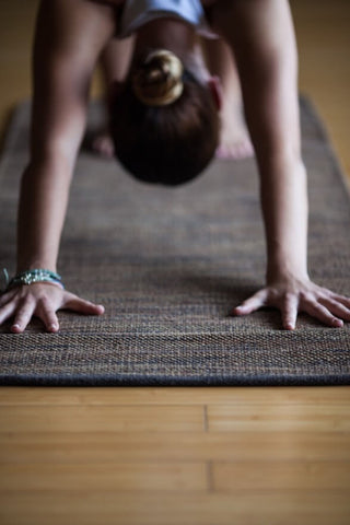 Front view of hands in a downdog yoga position.