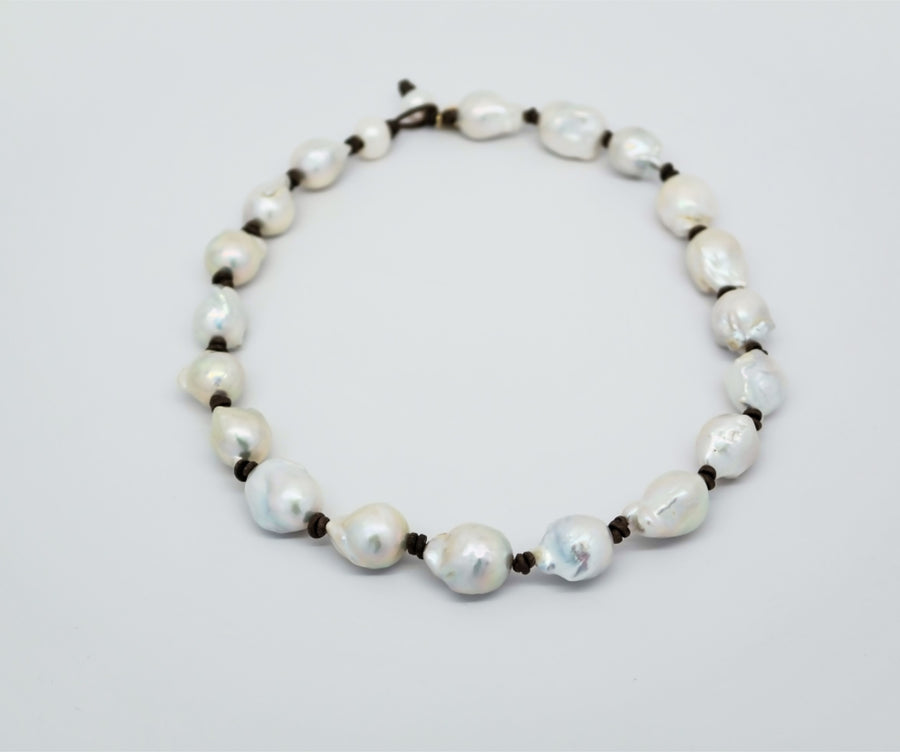 Choker: Large white baroque with leather knots