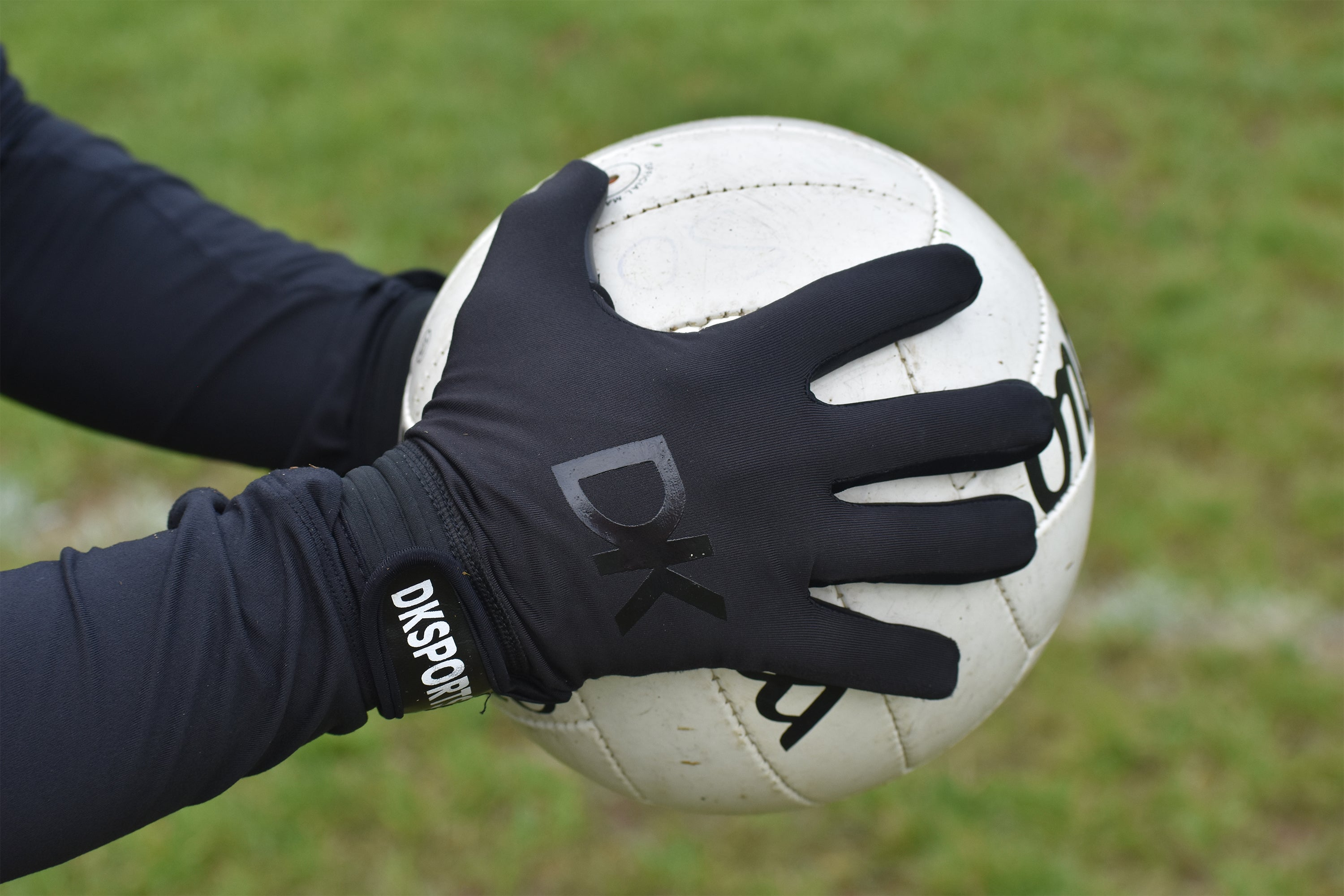 DK Sports Blacked Out Gloves provide firm grip of Gaelic football