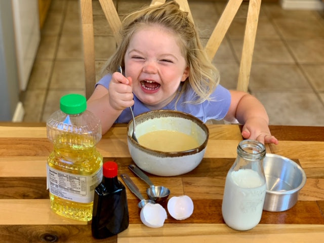 Little happy girl making Kids Cake Boxes personal sized cake kit for virtual party