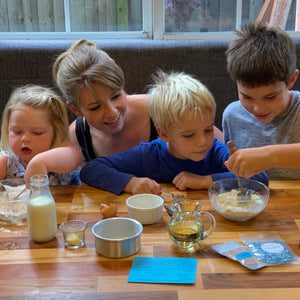 children and mother baking DIY cakes together for virtual birthday party. Kids Cake Boxes are a great idea for virtual parties for kids of all ages. @kidscakeboxes