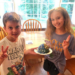 happy kids enjoying A Day at the Beach beach themed DIY cake baking kit from Kids Cake Boxes