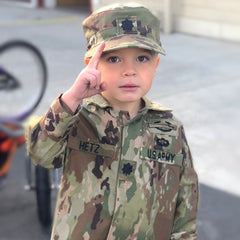Image of child in military uniform promoting Kids' Cake Boxes for ideas on how to keep military kids connected