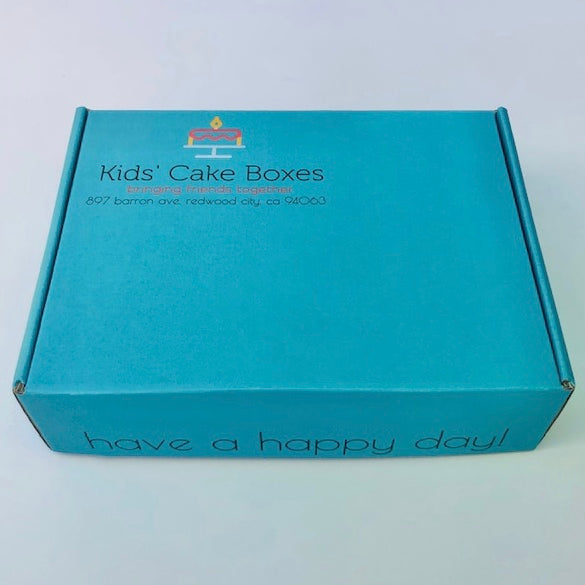 a picture of a closed Kids' Cake Boxes cake kit for virtual party