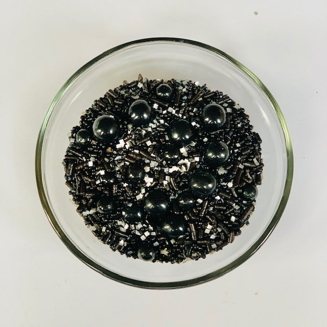 picture of bowl of black sprinkles for Kids' Cake Boxes virtual party cake kits