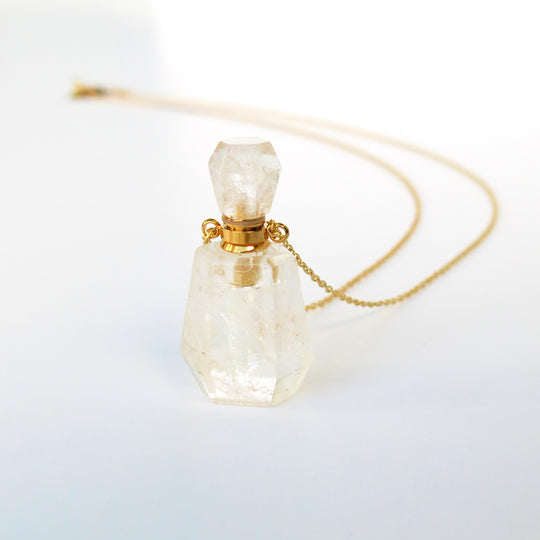 Valentine's Day gift ideas from MoonRox Jewellery & Accessories priced at $80 and less. Aroma Necklace with pendant that is a small functioning bottle for perfume or essential oils floating on a fine brass chain.