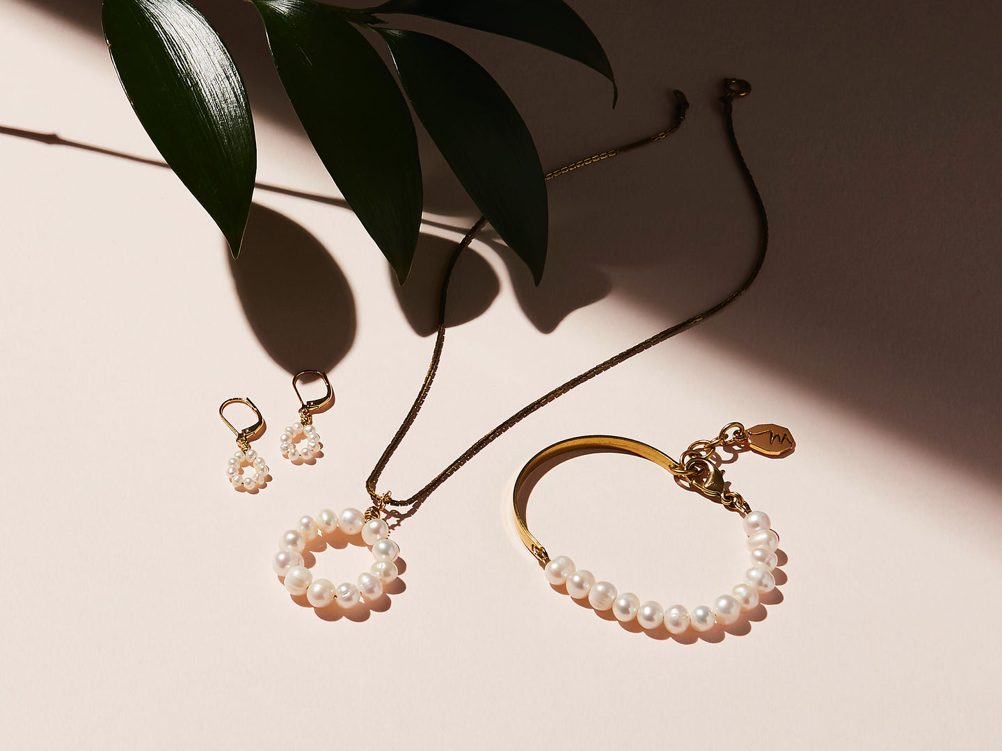 STILL LIFE | MoonRox Jewellery & Accessories Collection for Fall/Winter 2020. Illuminate Earrings, Necklace and Bracelet with brass and freshwater pearl.