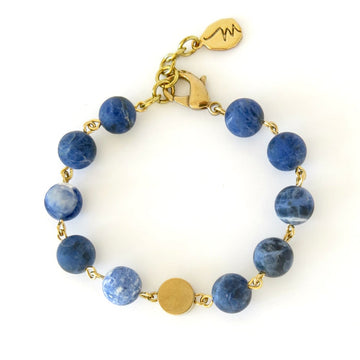 Ananda Bliss Bracelet by MoonRox Jewellery & Accessories - beaded jewellery with blue sodalite stones and brass centre piece.