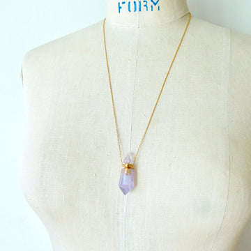 Aroma Necklace by MoonRox Jewellery & Accessories features pendant that is a small functioning bottle made of semi-precious stone. Shown in amethyst.