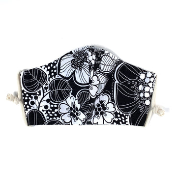 Washable fabric face covering by MoonRox in Robert Kaufman Black and White Floral cotton twill. Handmade in Toronto, Ontario, Canada