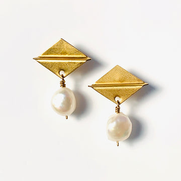Clio Stud Earrings feature a brass diamond shaped stud with freshwater pearl charms.