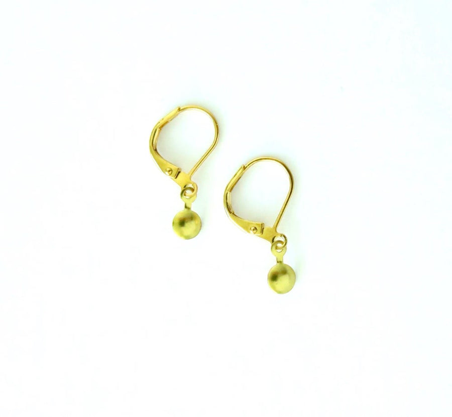 Teeny Dab Earrings by MoonRox - These earrings feature a very small brass charm on lever back ear hooks.