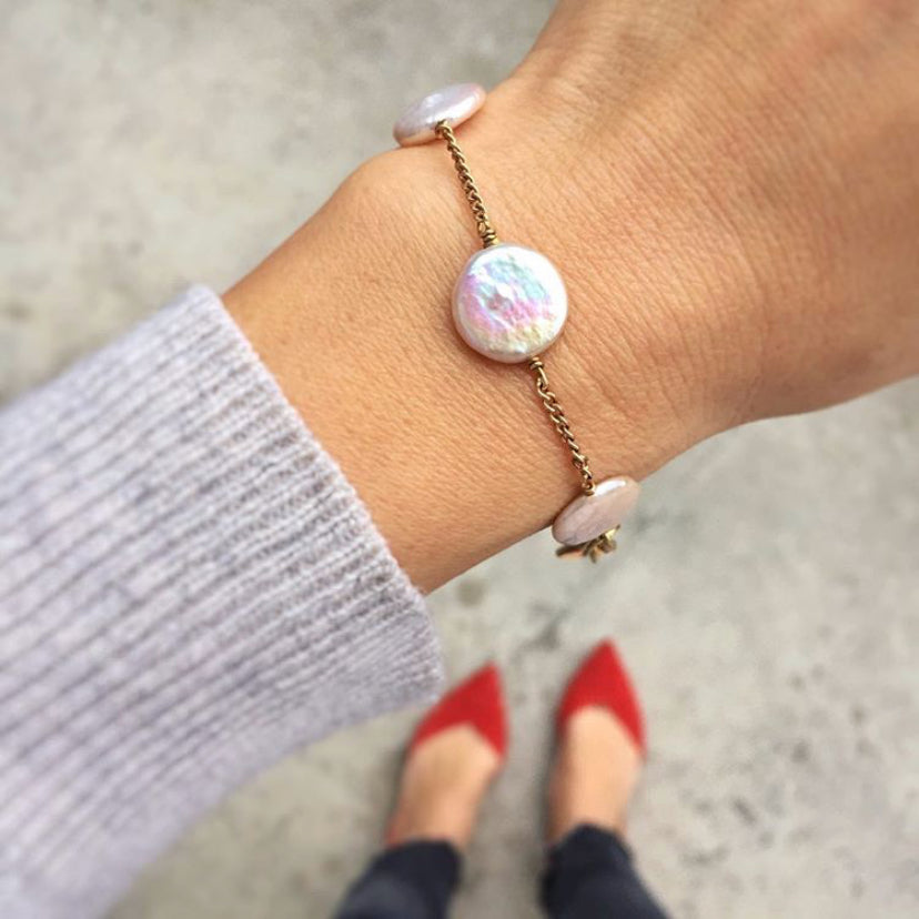 Dot to Dot Pearl Bracelet by MoonRox Jewellery & Accessories features freshwater pearl discs in Cloud spaced along fine chain. Shown worn on wrist.