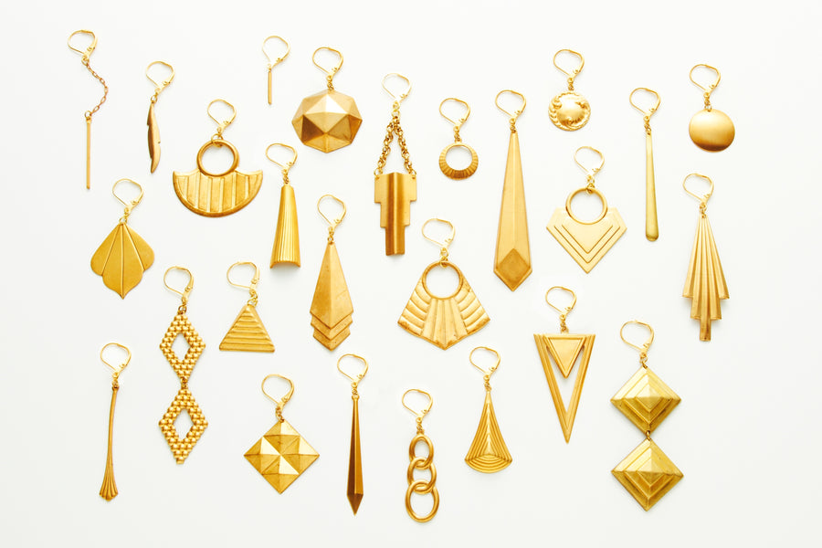A large selection of brass charm earrings from MoonRox Jewellery & Accessories.